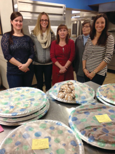 Junior League of Syracuse members bake cookies for Assumption Food Pantry, December 2013