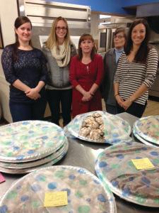 Junior League of Syracuse members bake cookies for Assumption Food Pantry, December 2013