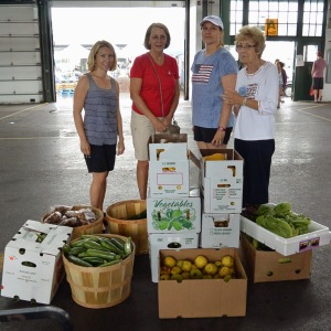 Junior League of Syracuse active and sustaining members at the Regional Market collecting produce for Assumption Food Pantry, July 2014